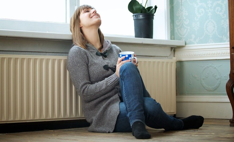 Woman Enjoying Home Heater After Heating Repair in Huntsville, AL